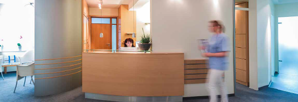 nursing walking pass receptionist table in a doctors office